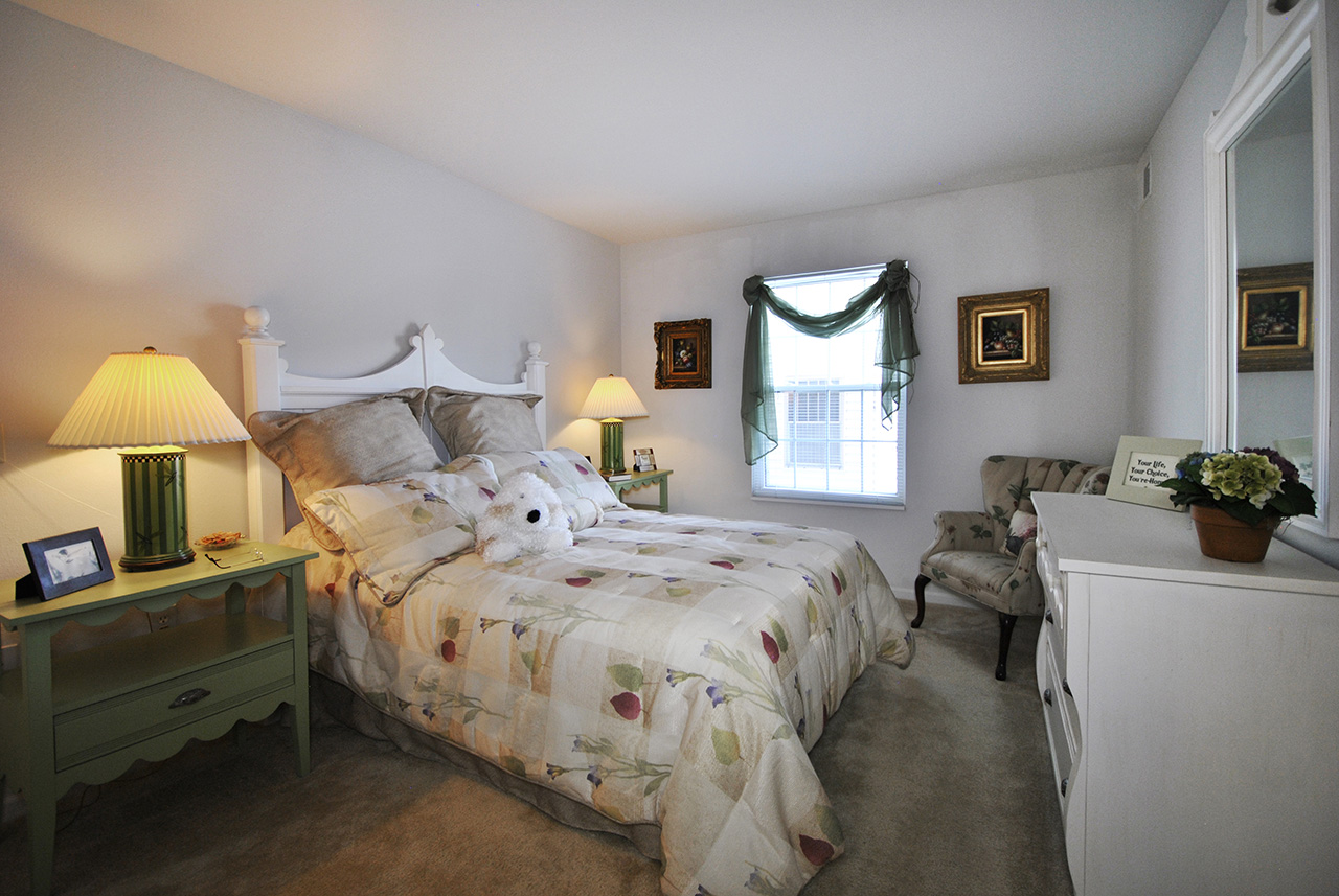 Bedroom with window in Swanhaven Manor apartment home