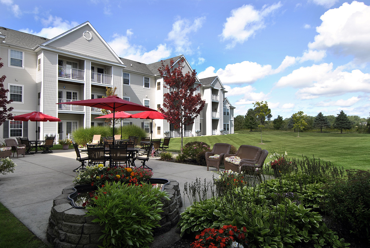Swanhaven Manor outdoor space with seating and umbrellas